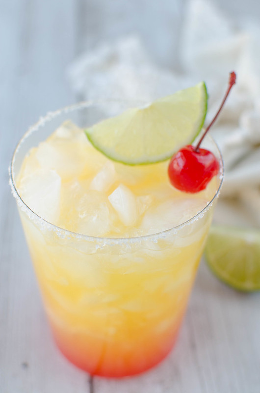 Skinny Tequila Sunrise Margaritas - a low calorie margarita recipe using low sugar orange juice, limes, tequila, orange liqueur, and a little grenandine. The perfect summer cocktail!
