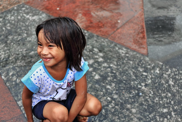 Little Filipino girl at play-courtyard off the Quiapo Church. Manila-Philippines-1011