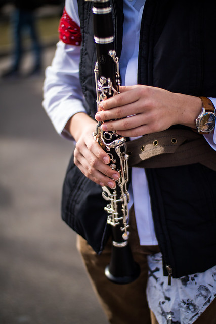 Musician at carnival with an oboe in hands