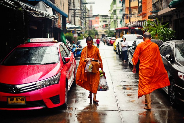 Two beg alms monks