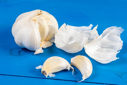 Fresh Garlic on the wooden board | by wuestenigel