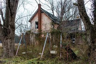 Abandoned house, Maryland Eastern Shore. Swingset and side of house
