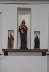 Blessed Virgin and child flanked by St Francis and St Dominic (20th Century) in 15th Century image niches