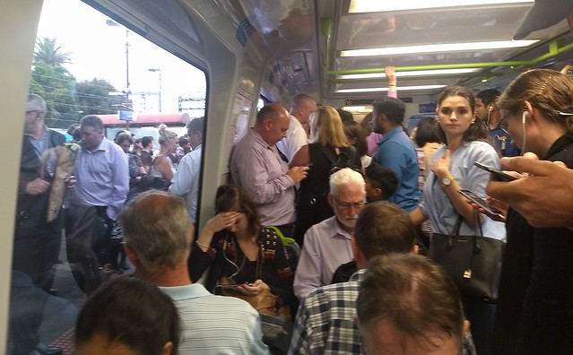 Crowded train and platform at Caulfield during service delays