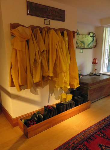 Complementary yellow rain coats and rubber boots at Sooke Harbour House in Sooke on Vancouver Island, Canada