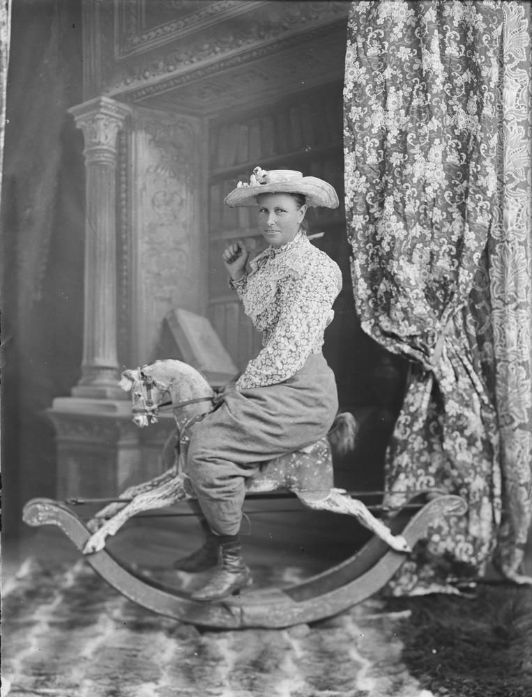 Self portrait on a rocking horse