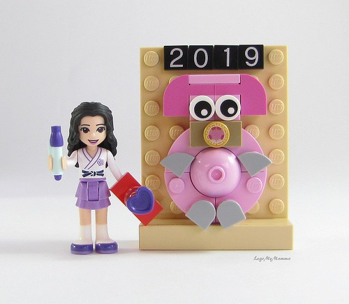 "Emma writes her wish next to her ""Year of the Pig"" art poster 