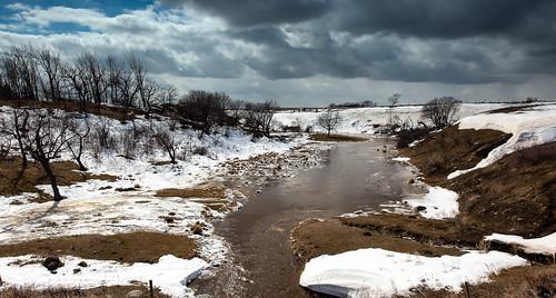 trees creek river melting water stream clouds rocks rural manitoba spring snow