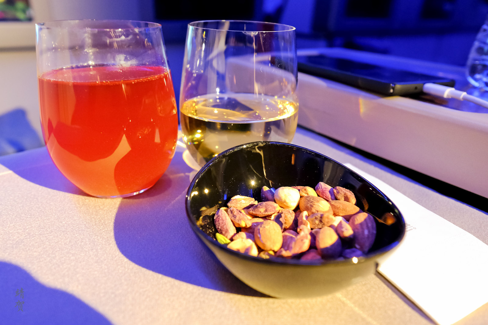 Nuts with white wine and cold tea