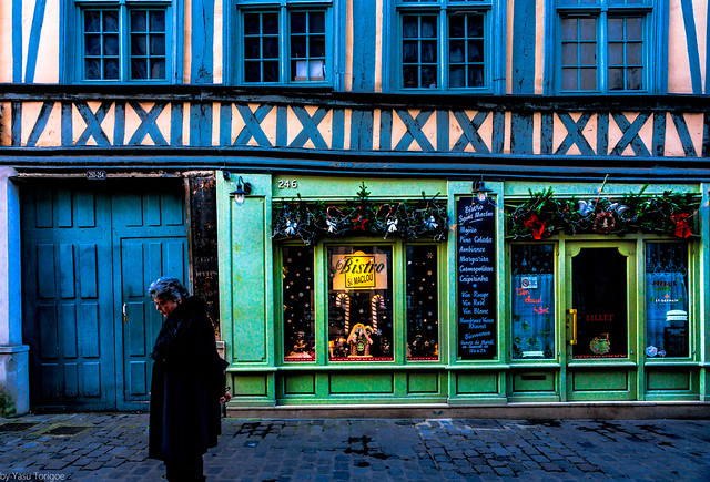 View of architecture of shops and people on streets in ancient houses of Old Town of Rouen city, the capital of Normandy region in France-51a