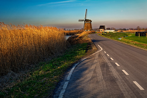 ruralscene nature landscape sky road outdoors scenics field blue europe sunset architecture nopeople travel summer agriculture old nonurbanscene grass 99 windmill winter reed
