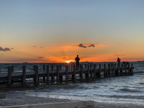 iphone australia brightonbeach brighton victoria portphillipbay water waves clouds sea shoreline dusk people photographer fishing pier ship silhouette seascape
