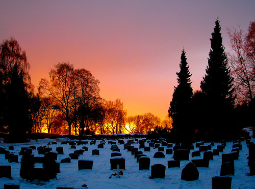 graveyard churchyard cemetery graves tombstones snow trees winter sunset dusk evening sky grefsen oslo norway