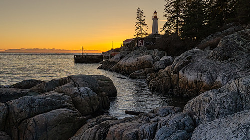 pointatkinson westvancouver lighthousepark lighthouse rocky shoreline rockcliffs westcoast outdoors rugged point britishcolumbia bc sonya73 orange glow graffiti sunset