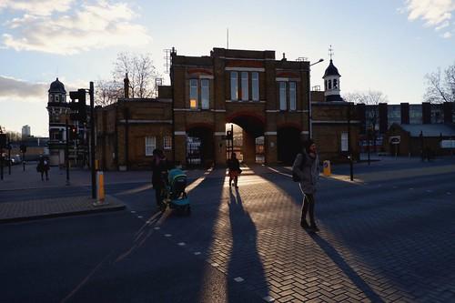 woolwicharsenal wonderfulwoolwich woolwich woolwichstreet royalarsenal woolwicharsenalgatehouse se18stories se18 fujifilm fujilovers fujifilmxt100 london southeastlondon timeoutlondon londonstreet londonist wintersun sunset shadows streetlife streetphotography