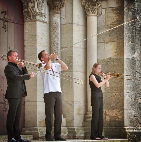 Musicians with old trombones and trumpets in front of the portal of the cathedral of Vezelay, France | by tarnpulli