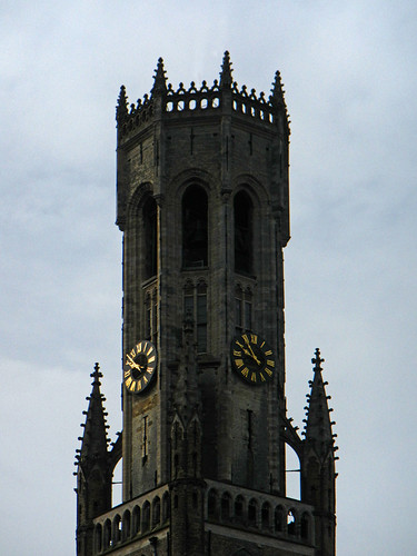 The clock on the bell tower in Bruges, Belgium