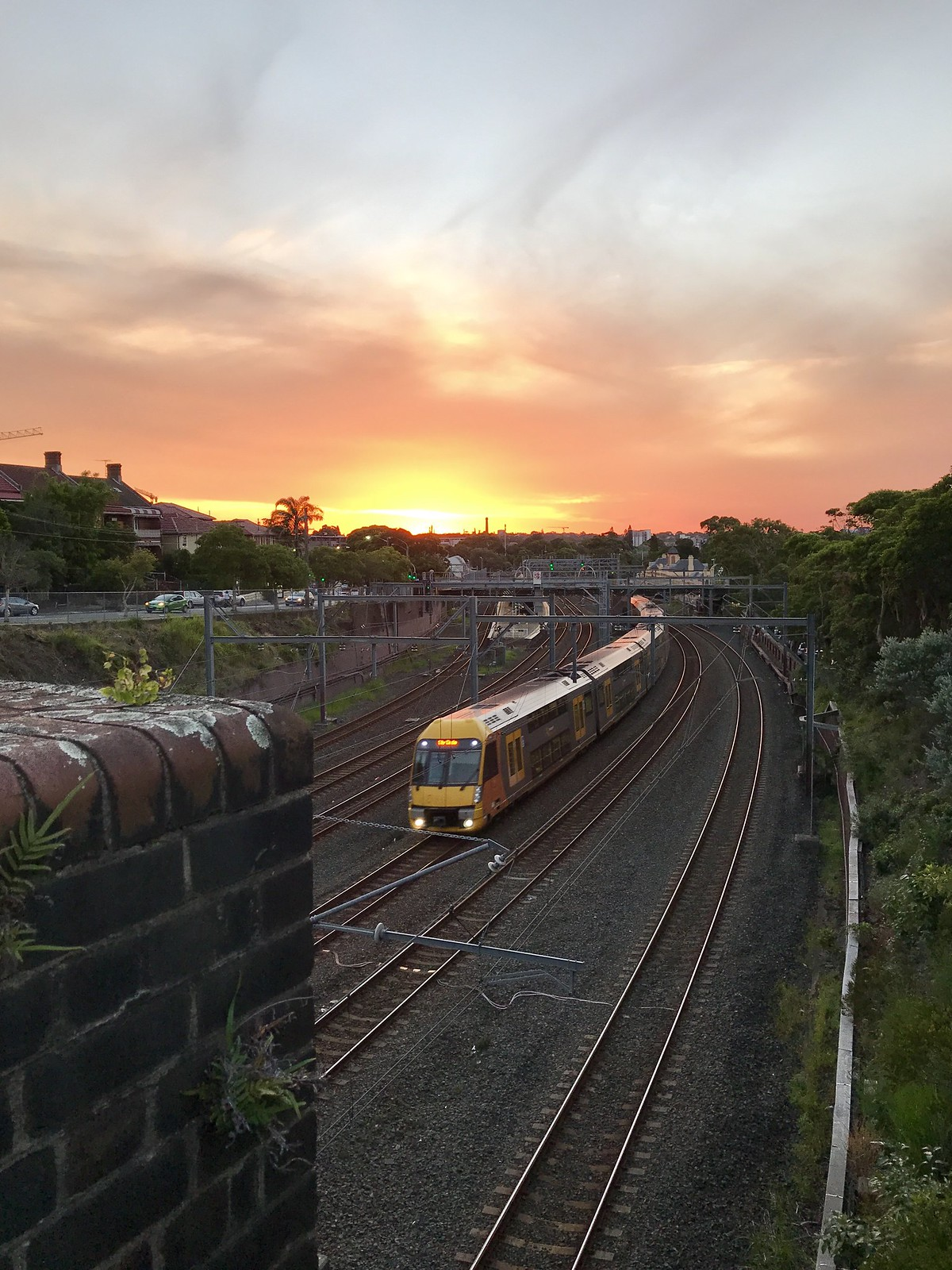 Petersham Station under a burning sunset, from the Chapel St bridge by Tim J.