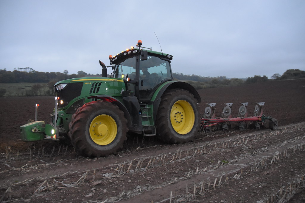 John Deere 6175R Tractor with a Kverneland 5 Furrow Plough