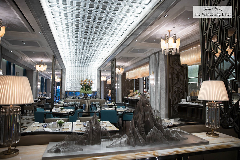 "Lavish intierior of Café Reign with a stainless steel mountainscape sculpture by Huang Qicheng ""Pure State - Series Three"" (2015)"