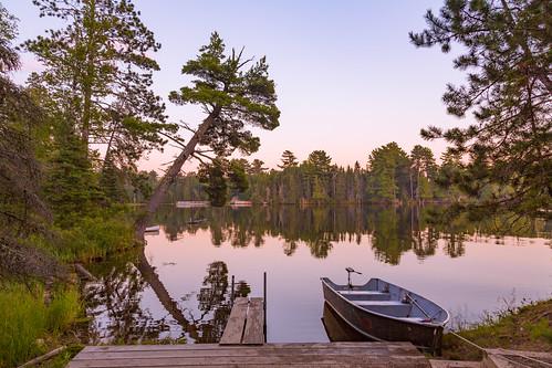 bearheadlake bearheadlakestatepark ely minnesota tonywebster boat statepark summer sunset trees