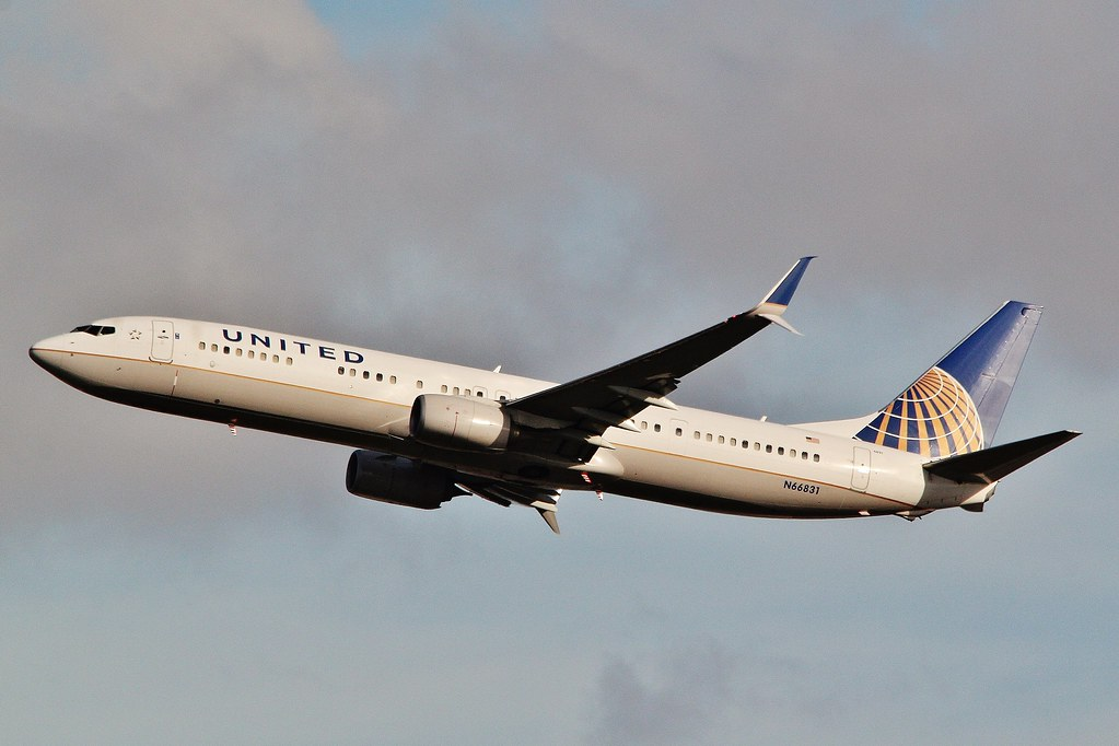 N66831 United Airlines Boeing 737-924(ER) departing from Orlando MCO .