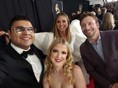 Farhan Merchant, Carolyn Ratcliffe, Heidi Klum, and Paul Salfen pose together on the red carpet of the 2019 GRAMMY Awards