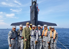 Vice Adm. Chareonpol Koomrasi, center, chief of staff of the Royal Thai Navy (RTN) Fleet, poses for a photo with U.S. Capt. Matt Jerbi, commodore of Destroyer Squadron 7 and other visiting RTN leaders during a tour of USS Louisville (SSN 724). (U.S. Navy/Lt. Matthew Ziesmer)