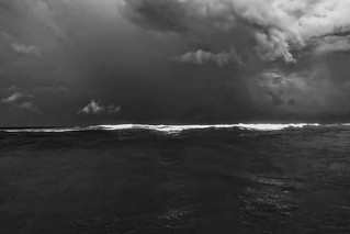 In the ocean as a storm approaches.