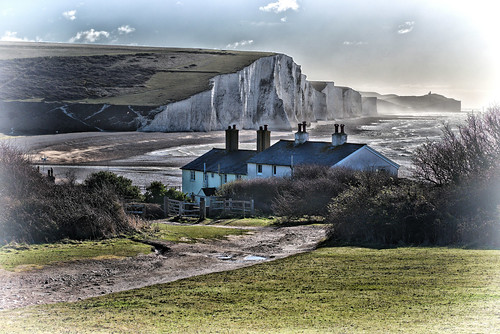 cottage house building chimney window fence track path bush grass sea ocean water beach cliff hill cuckmerehaven seaford sussex eastsussex southdowns nationalpark naturereserve sky cloud white green ghe