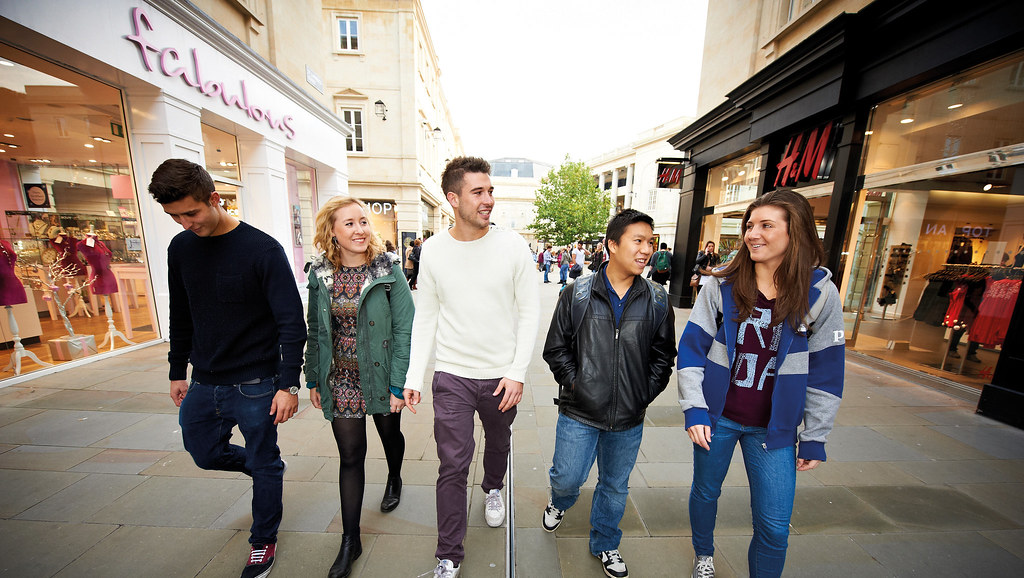 Students in a shopping street in Bath