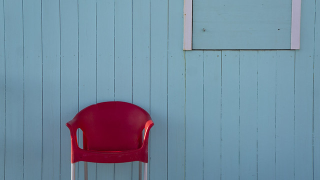 red chair on blue background