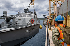 Sailors from Navy Cargo Handling Battalion (NCHB) 1, Det. Guam, lift a Mark VI patrol boat during a first-time proof of concept lift operation aboard USNS 2nd Lt. John P. Bobo (T-AK 3008), April. 4. (U.S. Navy/MC2 Jasen Moreno-Garcia)