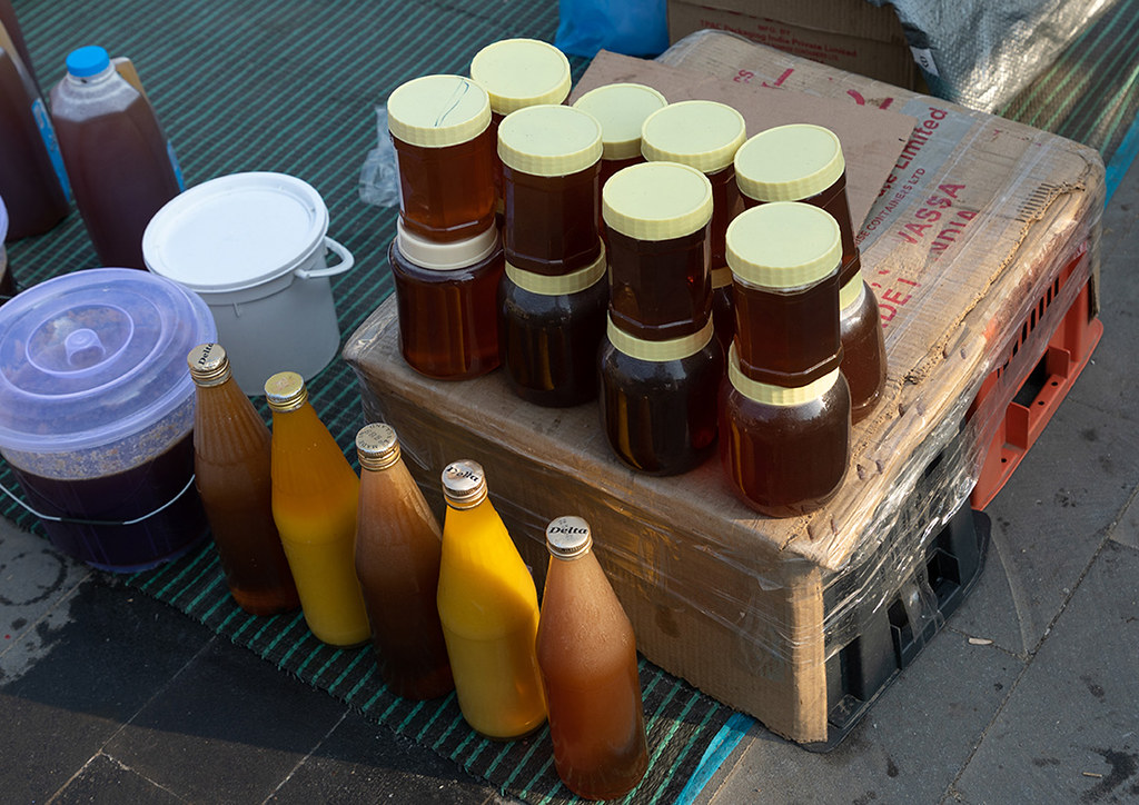 Honey for sale on a market, Asir province, Muhayil, Saudi