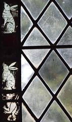 window border: hares and dragon? winged lion? (15th Century)