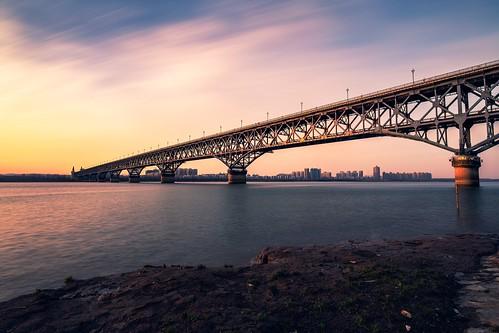 architecture sunset nanjing jiangsu peoplesrepublicofchina cn river longexposure bridge building beach urban dusk twilight sky cloud landscape landmark transportation train nikon nikond850 tamronsp1530f28
