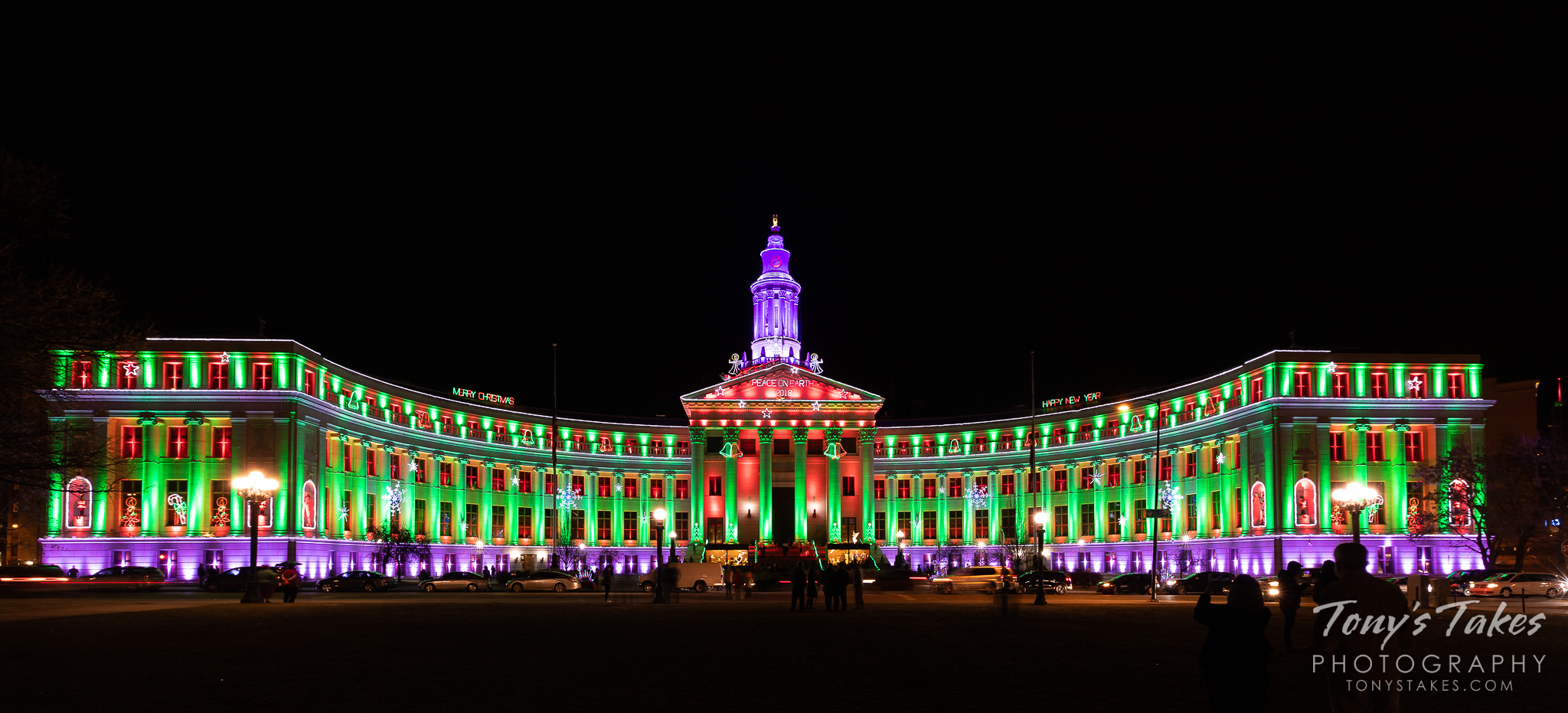 The Denver City and County building lit up in holiday colors for the season. (© Tony's Takes)