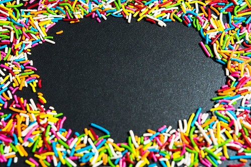 Rainbow sprinkles forming a frame | by wuestenigel