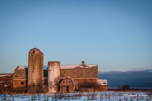 jeffersoncounty newyork upstatenewyork pamela barn redbarn rural farm silo snow winter newyork37 sunrise goldenhour abandoned neglected weathered