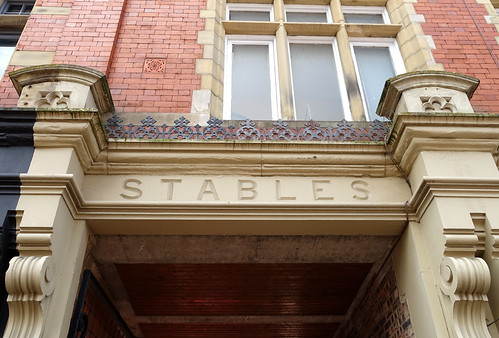 "Old ""Stables' sign on a building in Preston 