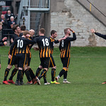 Kai Ross (8) is congratulated on his goal