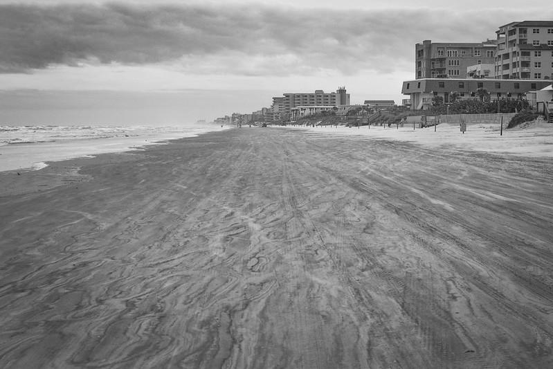 wind blown shoreline, sand, beach, darkened sky,  New Smyrna Beach, FL, Nikon D3300, mamiya sekor 45mm f-2.8,  1.30.19