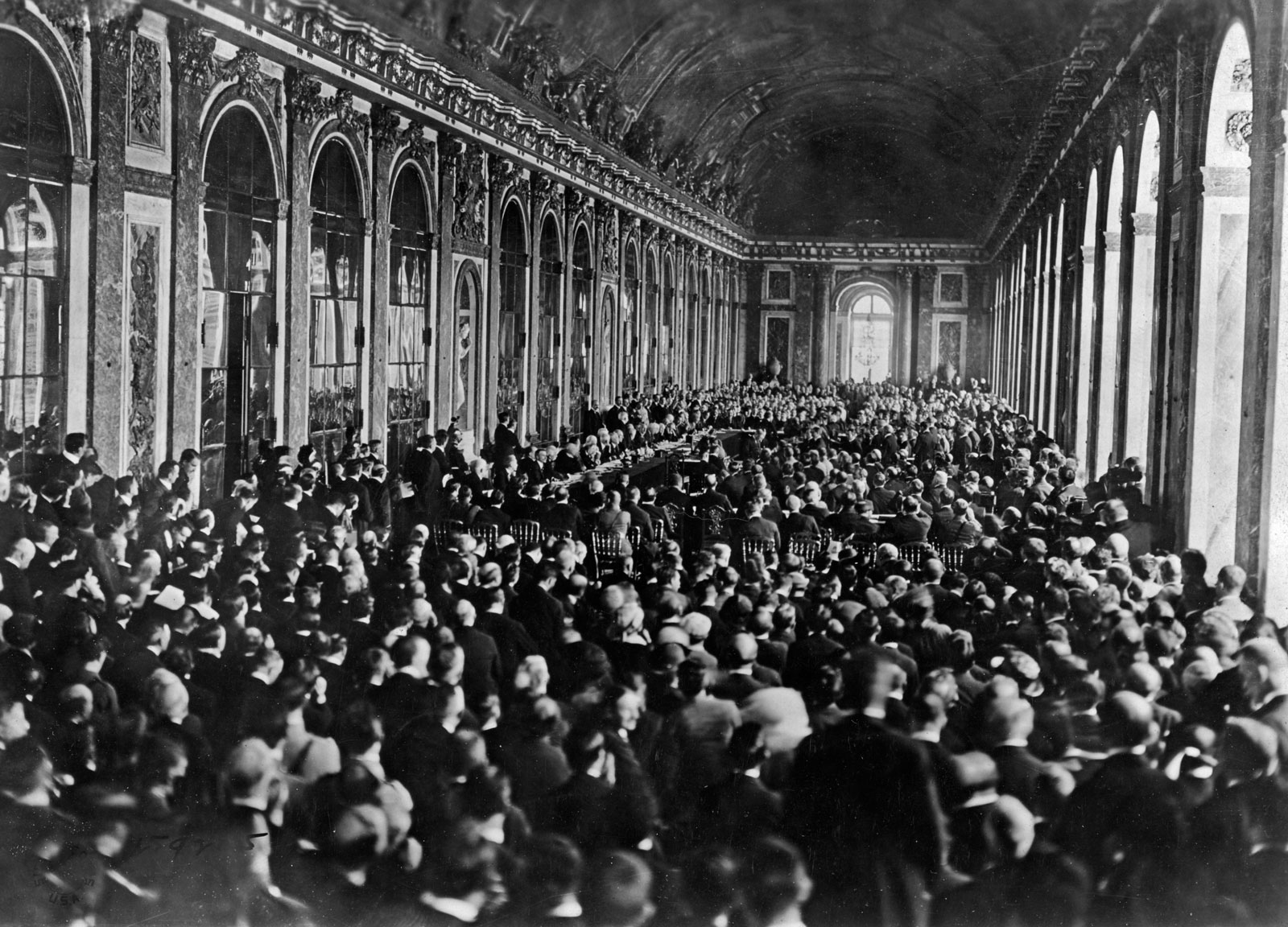 The signing of the Treaty of Versailles on June 28, 1919 in the Hall of Mirrors of the Palace of Versailles