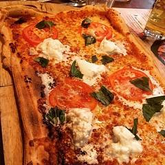 Bella Italia Queen Margherita Pizza Roma. Mozzarella & vine tomatoes on a Mediterranean sauce base of roast artichokes & peppers. Topped with fresh buffalo mozzarella & basil.