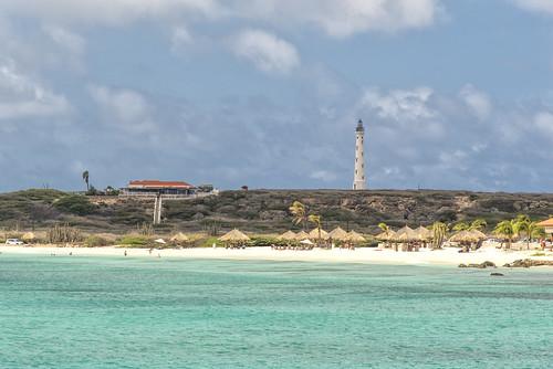 aruba island caribbean onehappyisland beach lighthouse sea water sand hill outdoor landscape clouds sky holiday sail travel traveller sun sunny