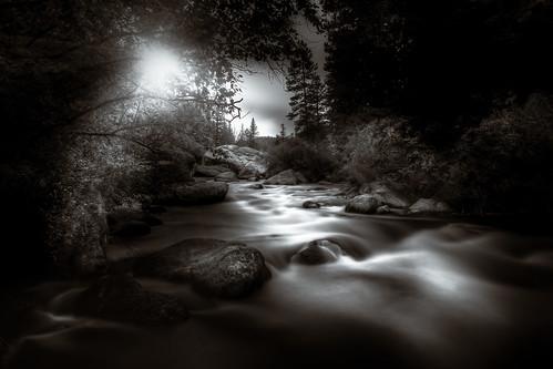 longexposure blackandwhite flowingwater river stream rockymountain sunset sunrays fineart dramatic