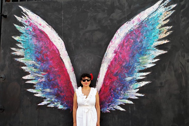 Woman in front of Colette Miller's Wings