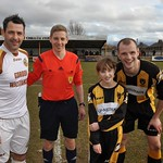Mascot with Captains Graeme Grant (left), Referee Calum Spence (centre) and Mark Lawson (right)