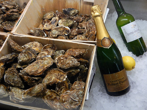 Oysters and Champagne for sale at Mercado San Miguel in Madrid, Spain