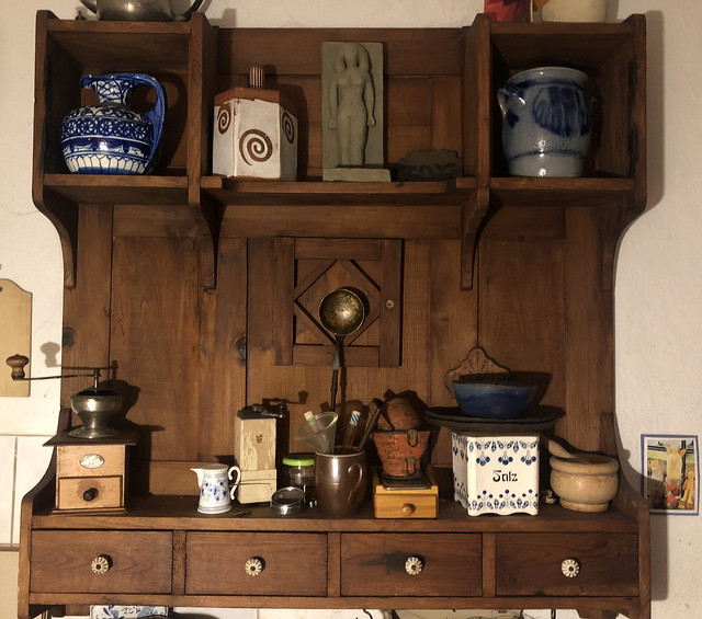 Old kitchen furniture can be great, and this wall-shelf with its contents is no exception.